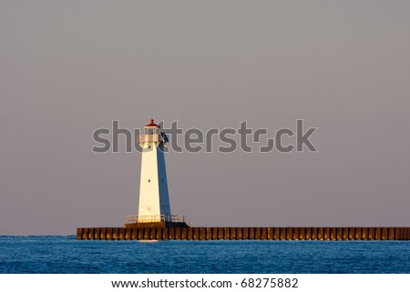 Sodus Bay Lighthouse on Lake Ontario in evening light at sunset