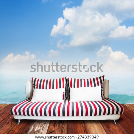 Sofa against background beautiful beach and tropical sea in summer. - stock photo