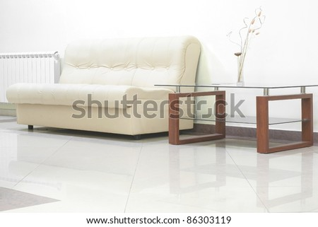 Sofa and glass table - stock photo