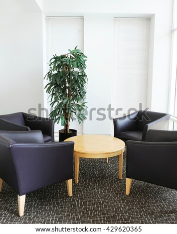 sofa and table in office lobby