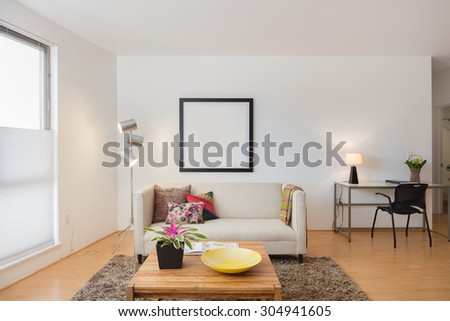 Sofa, Couch in modern living room adjacent to desk. - stock photo