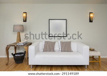 Sofa, Couch in modern living room with baskets for journals and books. - stock photo