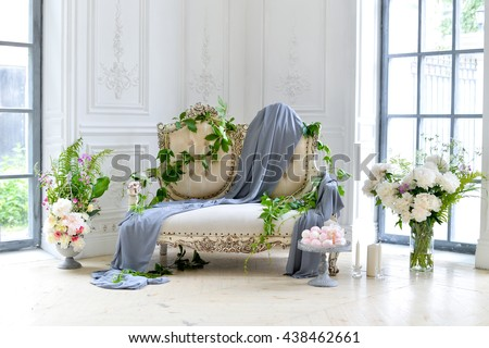 sofa decorating with flowers and cloth - stock photo