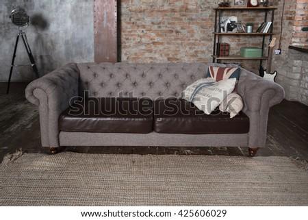 Sofa in a loft style interior - stock photo