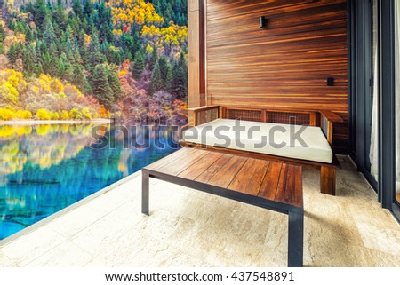 Sofa in living room on colorful lake background