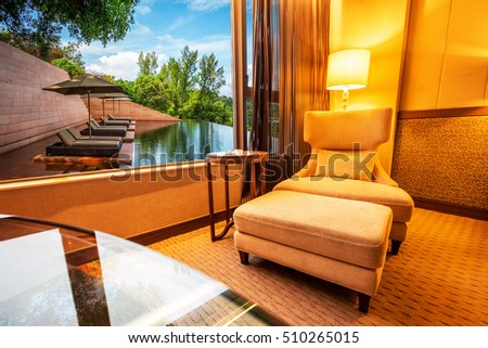 Sofa in living room with swimming pool background