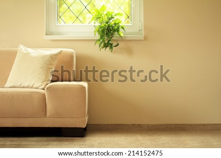 sofa under window - stock photo