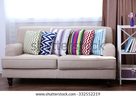Sofa with beautiful colourful pillows in the room