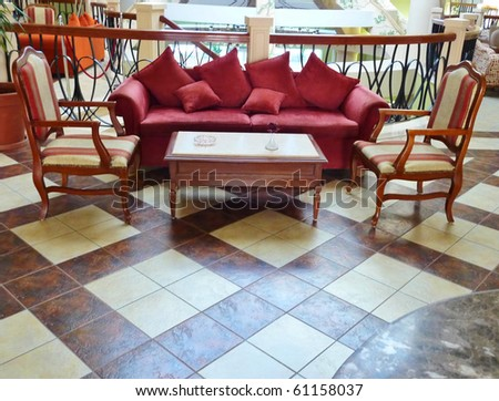 Sofa with chairs in a big hall of a hotel - stock photo