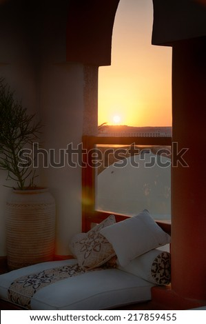 Sofa with Cushions near Window with Sunset View of Hurghada, Egypt - stock photo