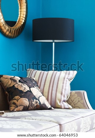 Sofa with pillows in an interior - stock photo