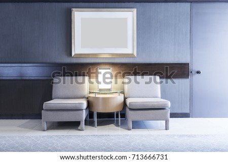 Sofas with lamp and blank photo frame on wall in room with light. Architecture, living room concept.