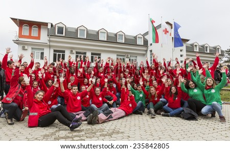 Sofia, Bulgaria - December 5, 2014: Members from Bulgarian Red Cross Youth (BRCY) voluntary youth organization are gathered for a photo after participating in a training simulation of a disaster. - stock photo