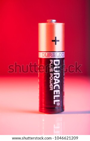 SOFIA, BULGARIA - FEBRUARY 28, 2018: Duracell Alkaline battery on red background