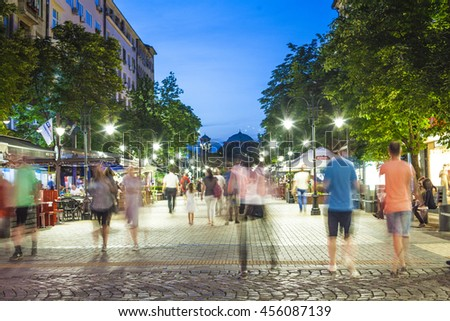 Sofia, Bulgaria - Jun 28, 2016:  Young people walking trough Vitosha boulevard after a hot summer day in Bulgarias capital city