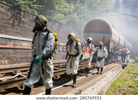 Sofia, Bulgaria - May 19, 2015: A team working with toxic acids and chemicals is saving people from a chemical cargo train crash. Teams from Fire department are participating in an emergency training.