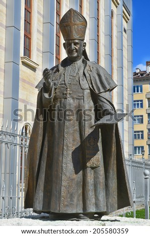 SOFIA BULGARIA SEPT 14: Statue of Pope John XXIII in front the Cathedral of St Joseph, which was consecrated by Pope John Paul II during his visit in 2002. On sept 14 2013 in Sofia Bulgaria - stock photo