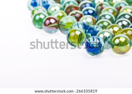 Soft abstract image of colourful marbles on white background with copy space. - stock photo