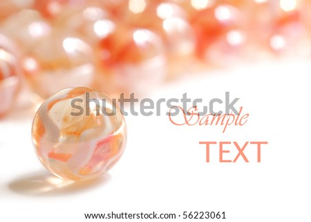 Soft abstract image of pastel colored marbles on white background with copy space.  Macro with extremely shallow dof. - stock photo