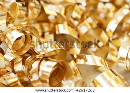 Soft abstract image of shiny gold ribbons with polka dot design.  Macro with extremely shallow dof. - stock photo