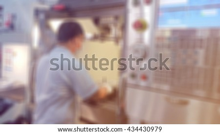 Soft and blurred image of mechanical technician service engineer worker at CNC machining center in factory /industry concept for background use - stock photo