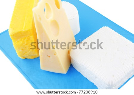 soft and hard cheeses on big blue plate - stock photo