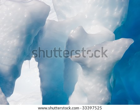 soft and sharp edges of an iceberg - stock photo