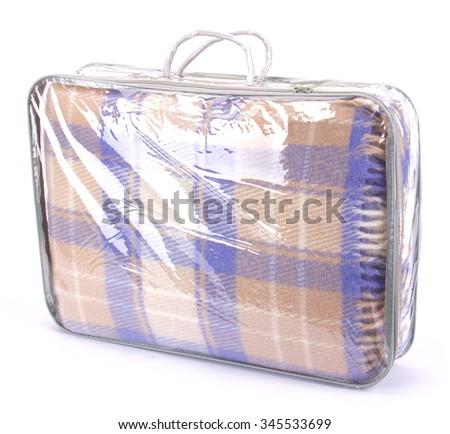 Soft and warm folded wool plaid with fringe in plastic bag