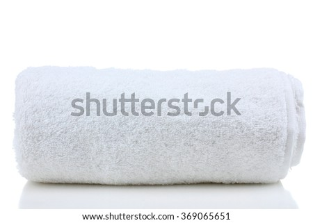 soft bath towel rolled up on a white isolated background - stock photo