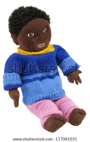 Soft black doll with homemade knitted woolen clothes - stock photo