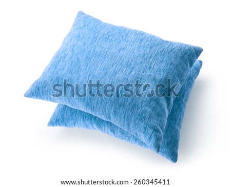Soft blank blue pillows on white background - stock photo