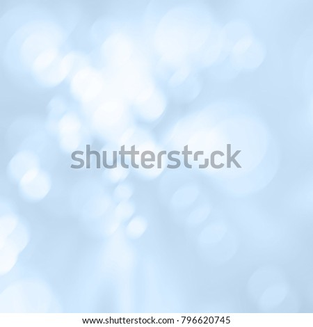 Soft blue background with white blurred bokeh lights - abstract sunburst texture