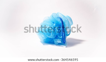 Soft blue bath puff or sponge with rode handle isolated on white background. - stock photo