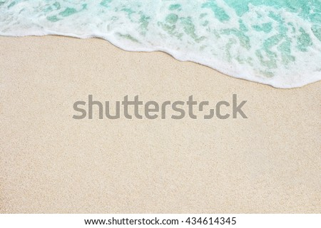 Soft blue ocean wave on sandy beach. Background. - stock photo