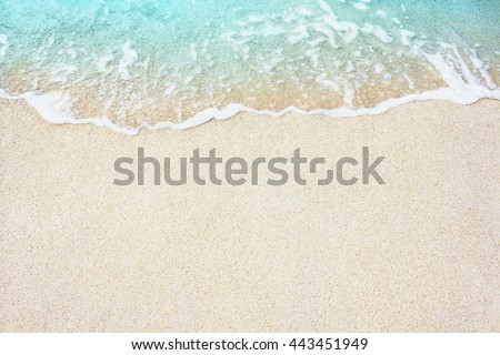 Soft Blue Ocean Wave On Sandy Beach. Background. Selective focus. - stock photo