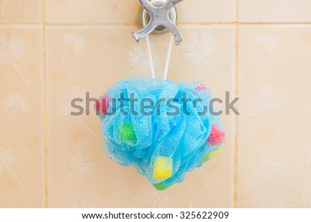 Soft blue synthetic sponge for showering - stock photo
