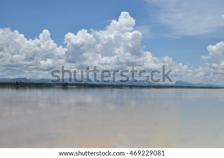 Soft blurred and soft focus the beautiful sky and cloud at noon at Mekong river,international border between Nakhon Phanom, Thailand and Thakhek district , Laos PDR.