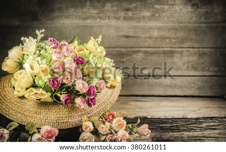 Soft blurred of roses in vintage style on wooden background dark tones. - stock photo