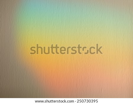 Soft blurred rainbow effect background with applied texture in muted pastel colors of the spectrum for a dreamy spiritual background - stock photo