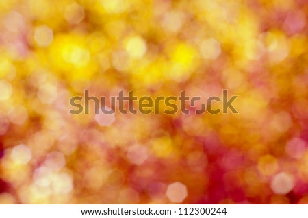 Soft, blurry, photographed bokeh background of pinks and yellows.