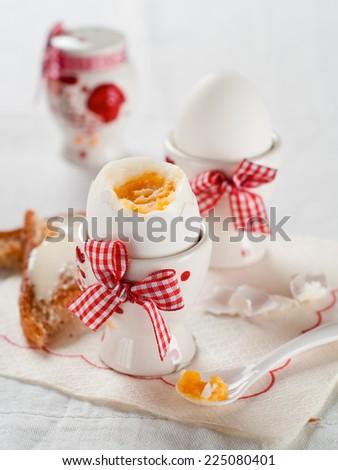 Soft boiled egg for breakfast, selective focus - stock photo