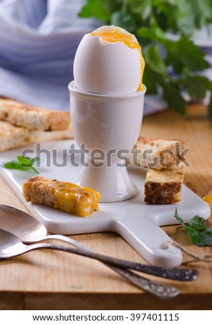 soft boiled egg with toast soldiers - stock photo
