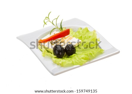 Soft cheese on salad with olives and rosemary