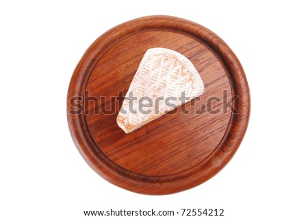 soft cheese served on wood over white - stock photo