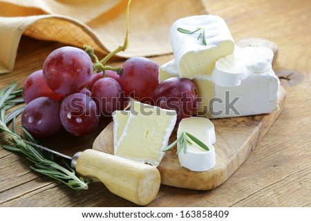 soft cheese with a white mold  (brie, camembert) - stock photo