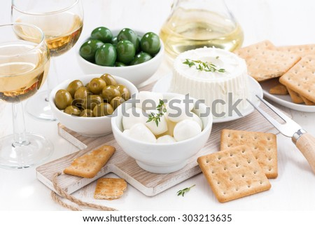 soft cheeses, crackers and pickles, horizontal - stock photo