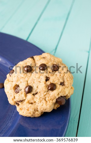 Soft chocolate chips cookie on a blue background