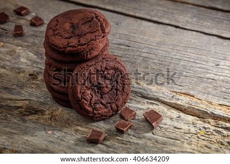 Soft chocolate cookies set on old wooden surface