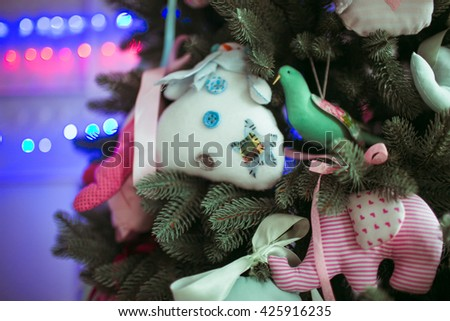 soft Christmas toys on the Christmas tree - stock photo