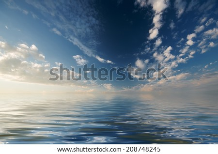 Soft cirrus clouds are illuminated by the setting sun on the calm sea background - stock photo